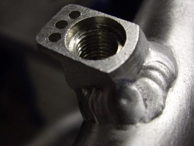 Lassen van nokken voor V-brake dienende als handrem